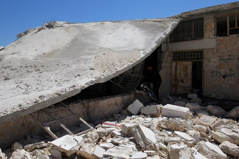Развалины в сирийском городе Хан-Шейхун / REUTERS