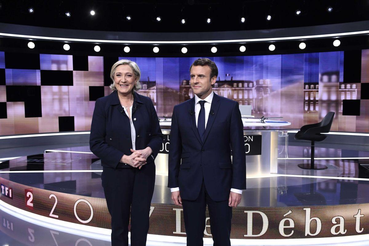 Марин Ле Пен и Эммануэль Макрон / REUTERS