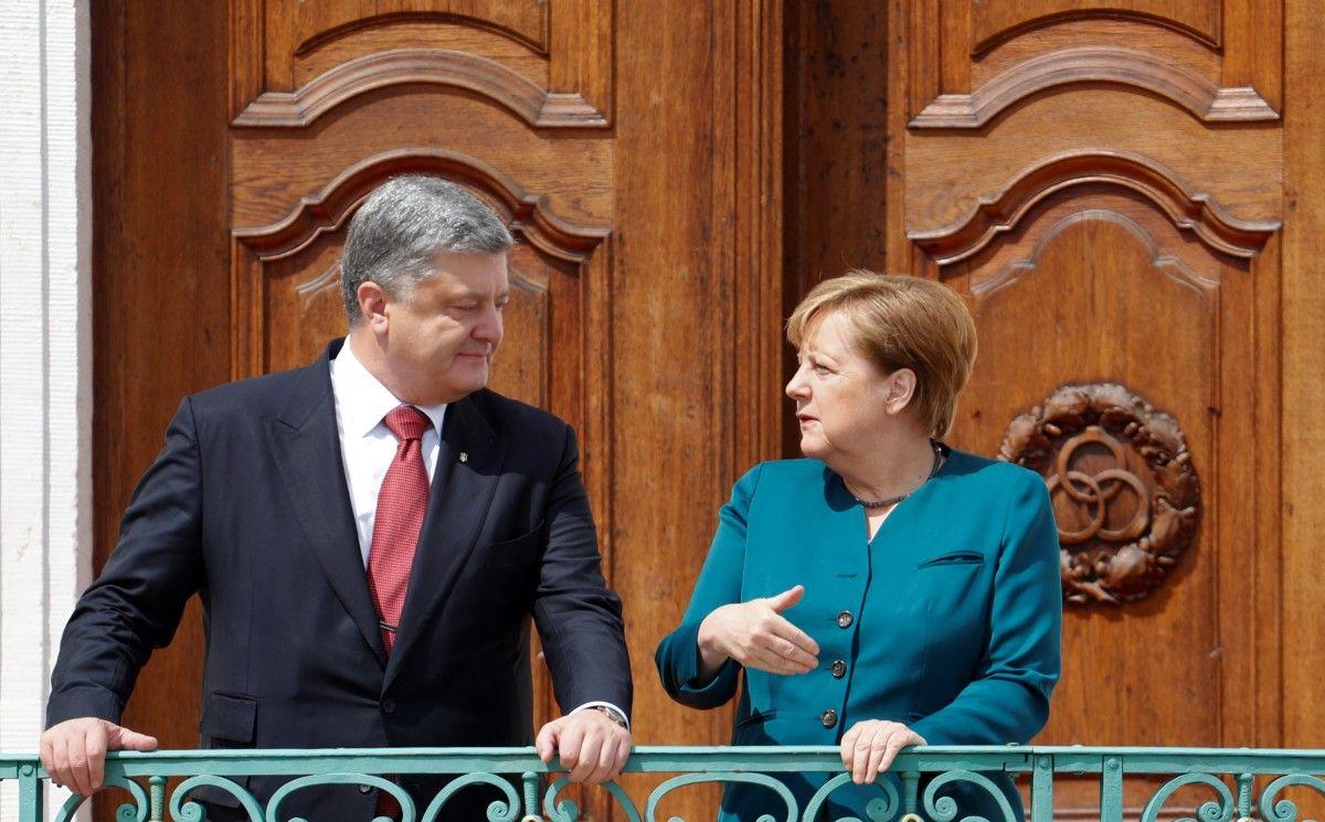 Меркель розповість Порошенку про свої зустрічі з Путіним і Макроном