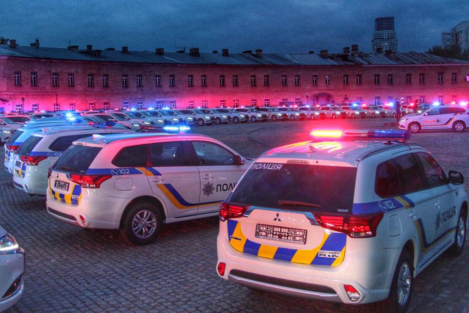 Kyiv police stage light show with new patrol vehicles