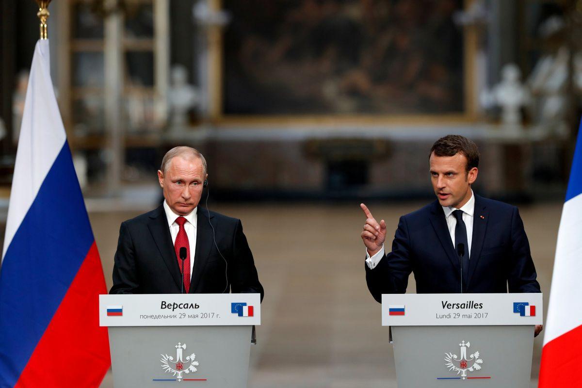 Putin and Macron / REUTERS