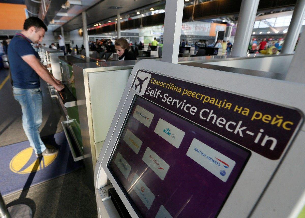 """Стойка регистрации в аэропорту """"Борисполь"""", иллюстрация / REUTERS"""