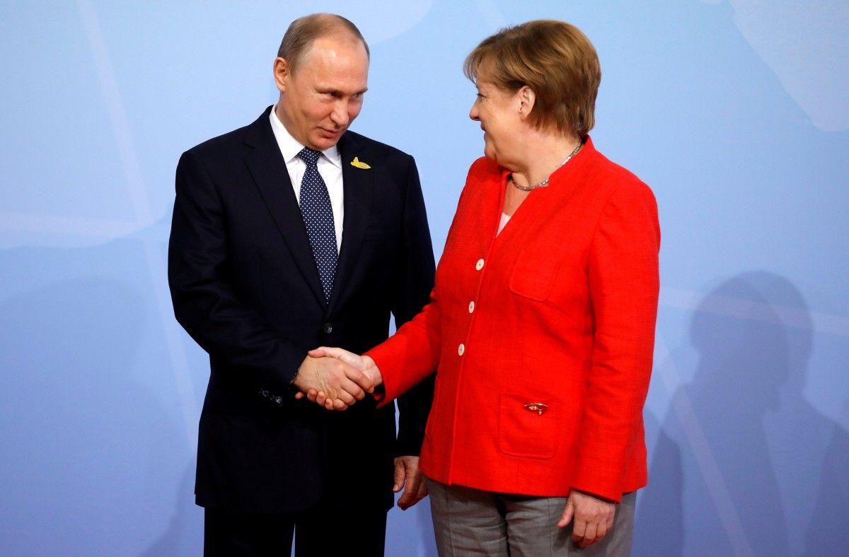 Russian President Vladimir Putin and German Chancellor Angela Merkel / REUTERS