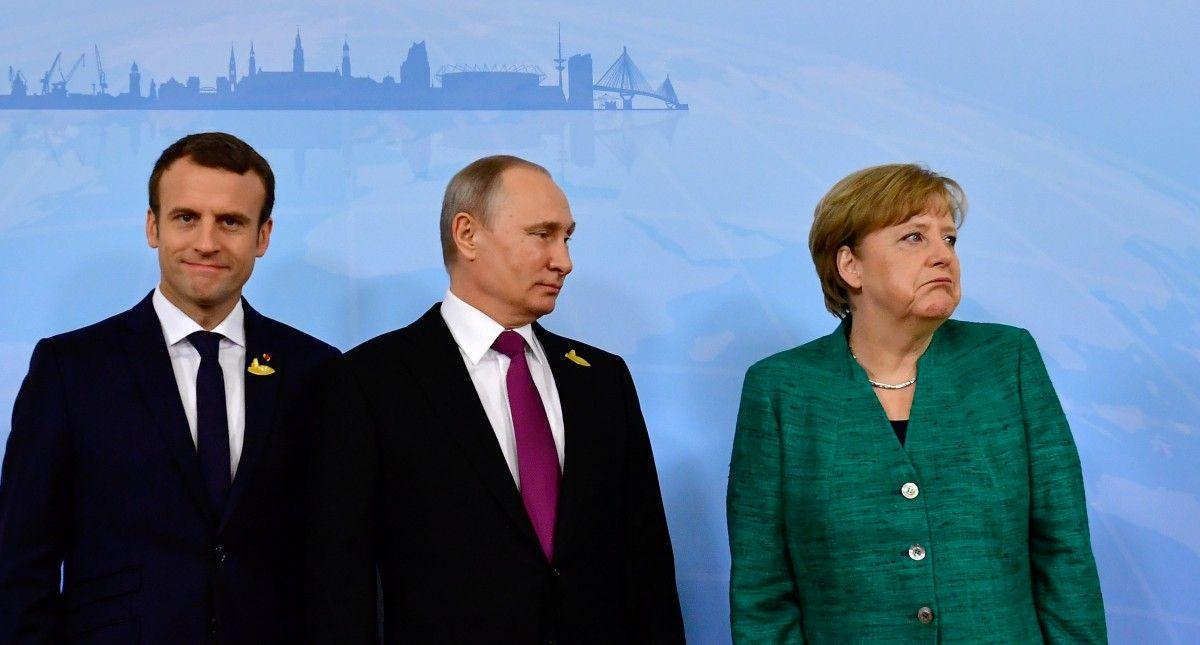 Встреча Макрона, Меркель и Путина по поводу ситуации в Донбассе / REUTERS