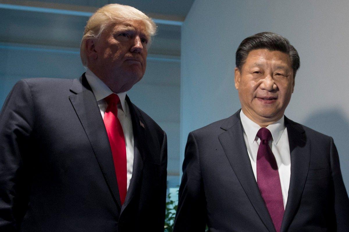 Дональд Трамп и Си Цзиньпин / REUTERS