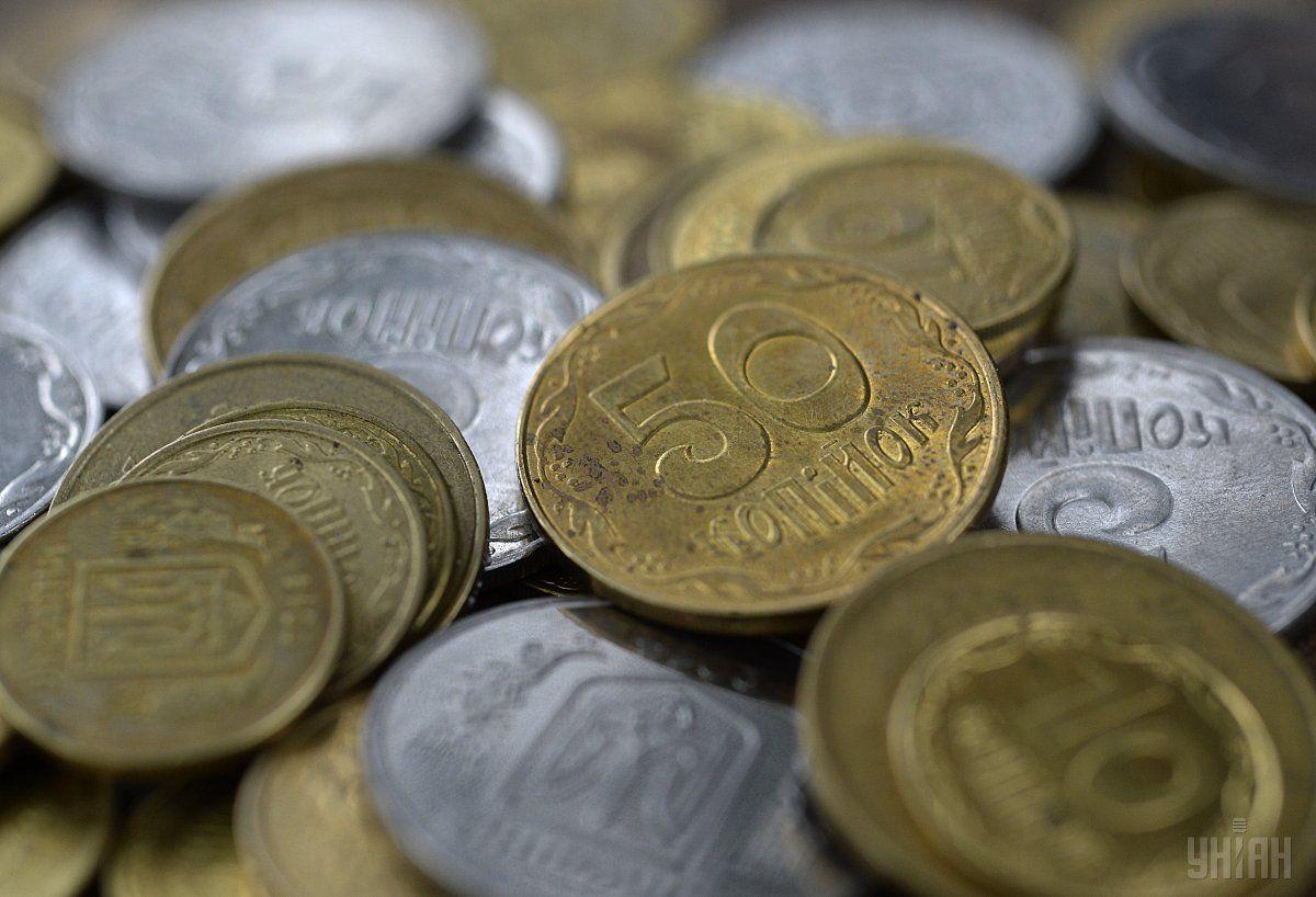 С открытия торгов гривня укрепилась по отношению к доллару на 15 копеек / фото УНИАН
