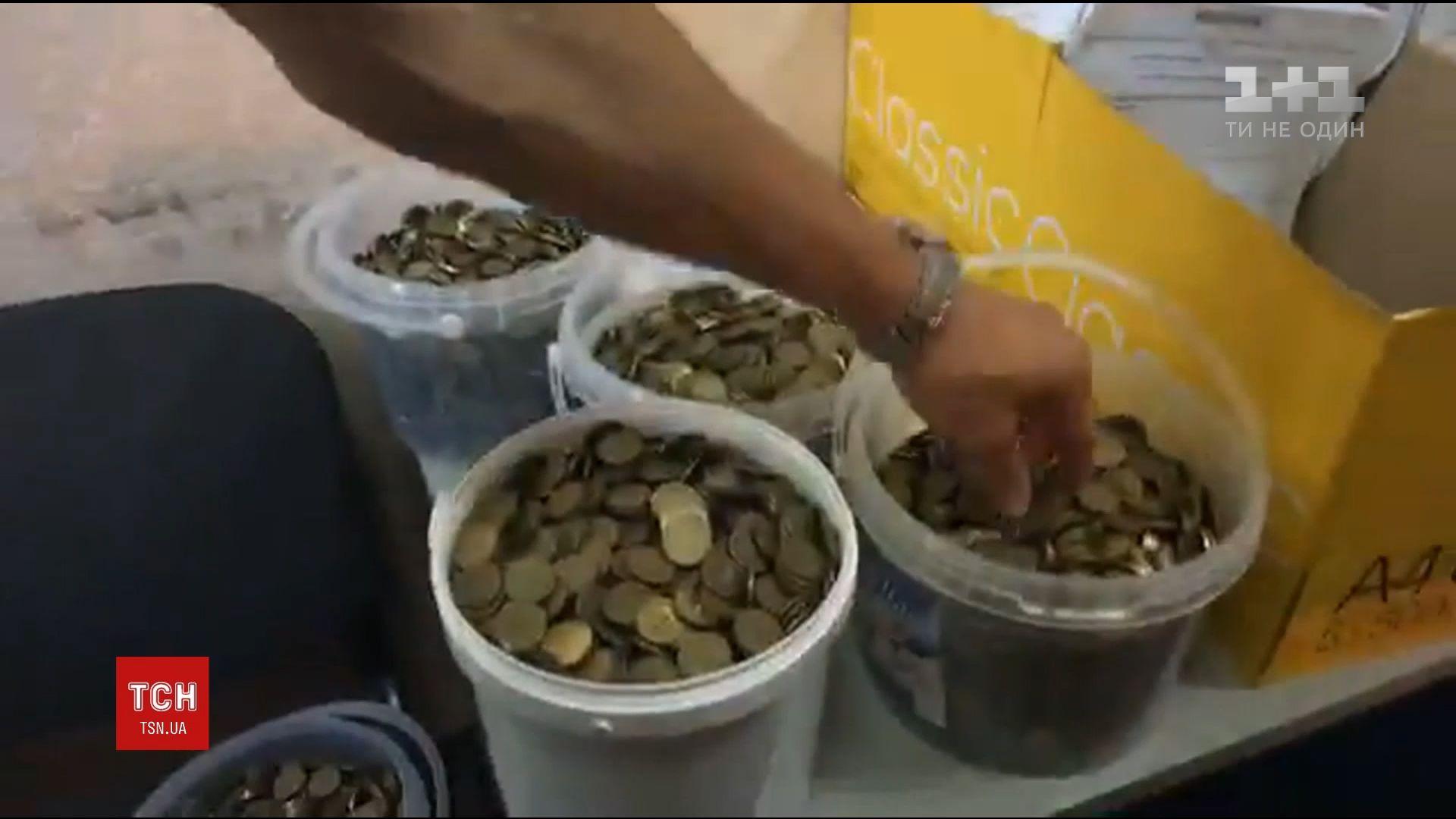 Активисты принесли 140 килограммов монет / скриншот