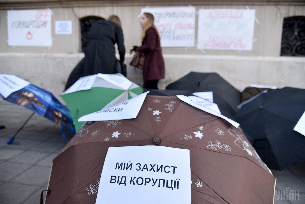 Коррупция позволяет украинским властям контролировать экономику / УНИАН