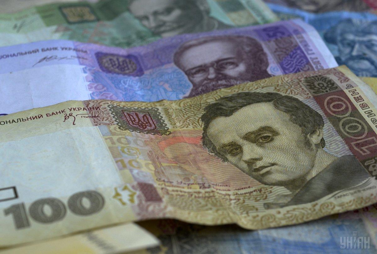 Текущие котировки гривни на 9 копеек ниже уровня открытия торгов / фото УНИАН