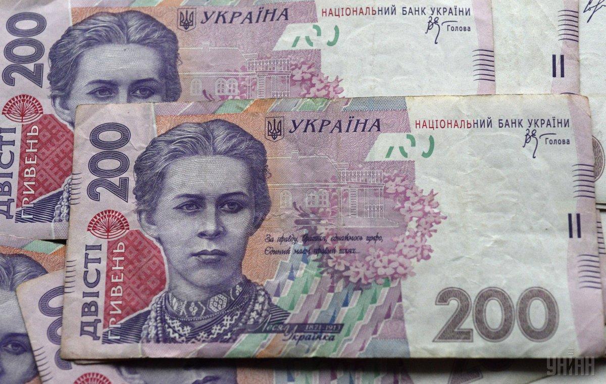 Гривня зміцнилася по відношенню до долара на 25 копійок / фото УНІАН