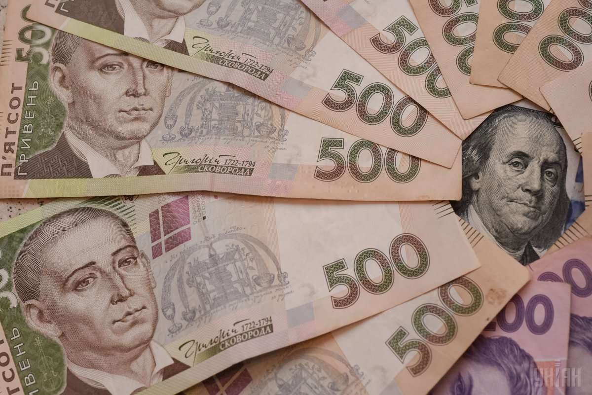 Гривня опустиласядо долара на 2 копійки / фото УНІАН