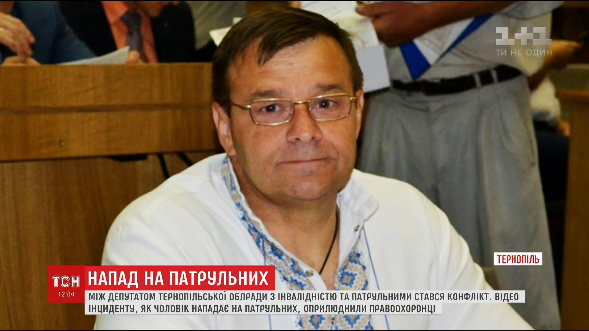 Депутат на інвалідному візку побив жінку-поліцейську / скріншот ТСН