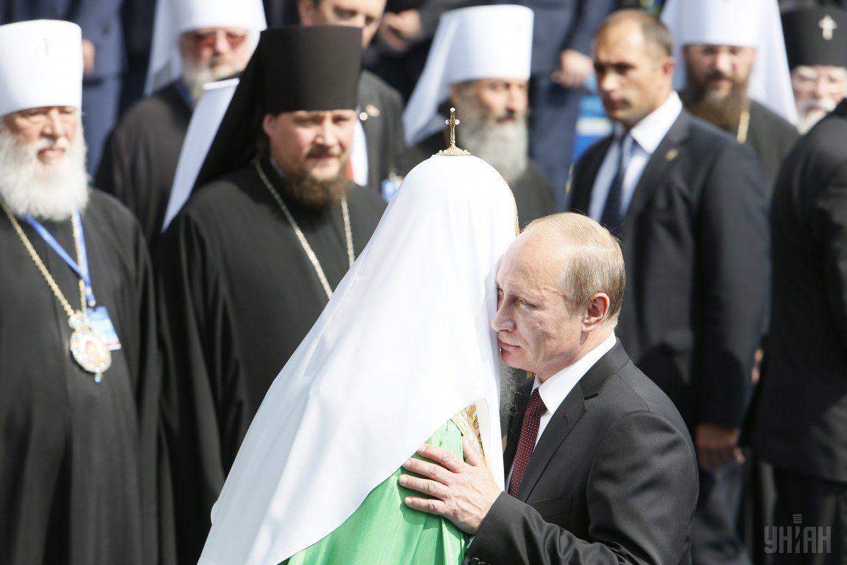 Патриарх Кирилл с Владимиром Путиным / фото УНИАН