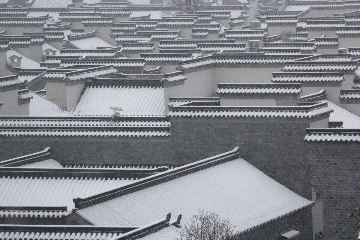 Дахи покриті снігом в Нанкіні, провінція Цзянсу. Китай / REUTERS