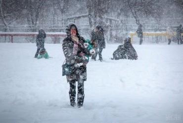 Последствия непогоды в Украине: города и села страдают от зимнего ливня и снежного Армагеддона (фоторепортаж)