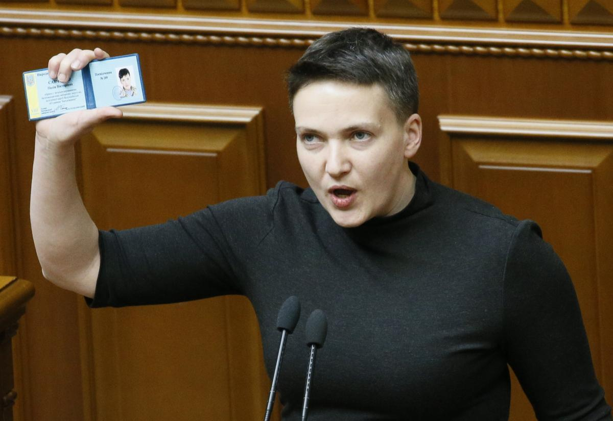 Savchenko in parliament, holding an MP's card / REUTERS