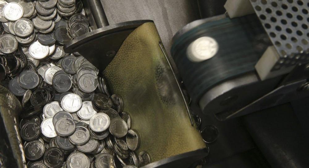 В Україні карбують нові монети  як створюють металеві 1 та 2 гривні (фото 064c2bf6a4b2e