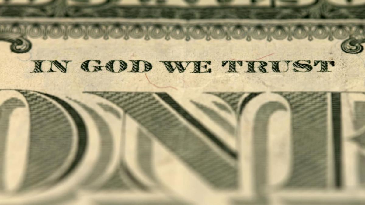 Фраза «In God we trust» на доларах США / thedailybeast.com
