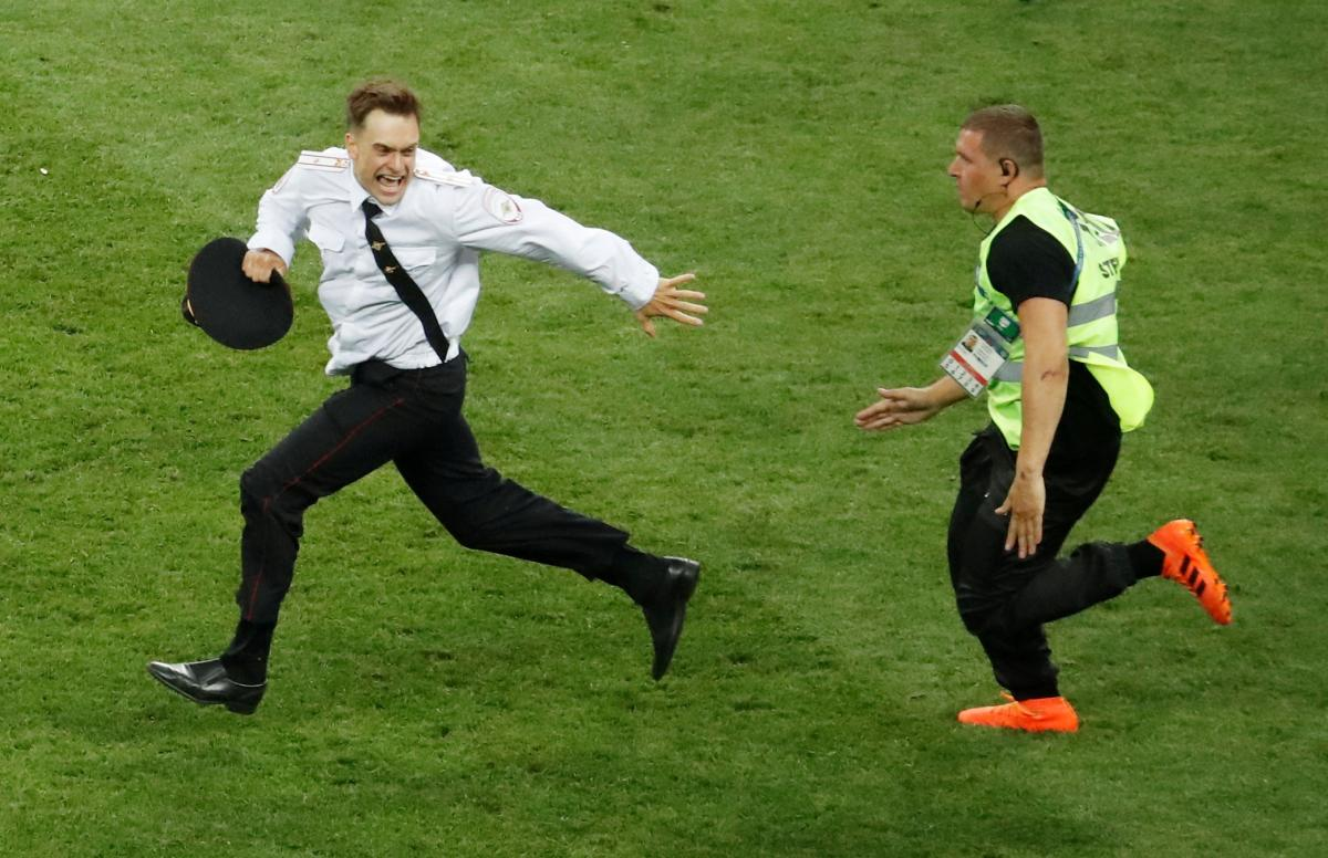 Pussy Riot activist Verzilov ran onto the pitch during the World Cup final / REUTERS