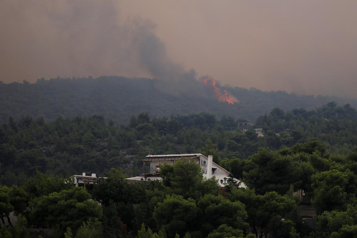 Пожежа в селищі Кінета / REUTERS