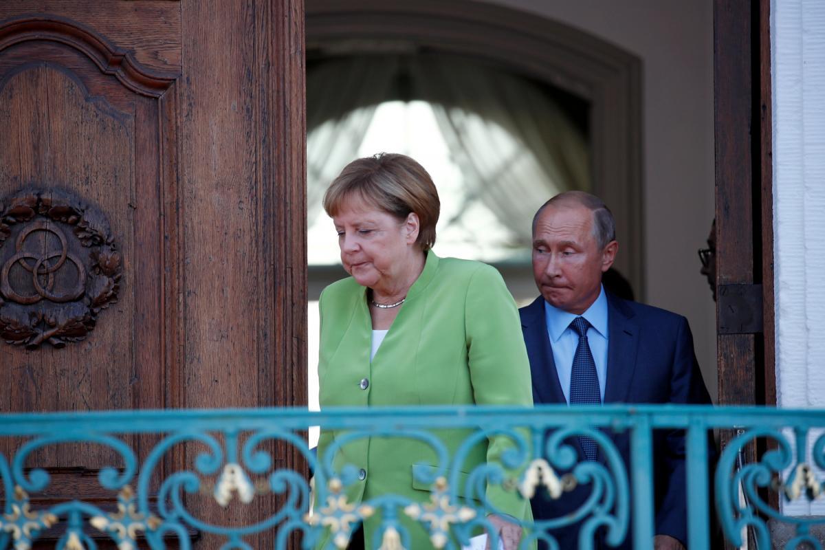 Ангела Меркель та Володимир Путін / REUTERS