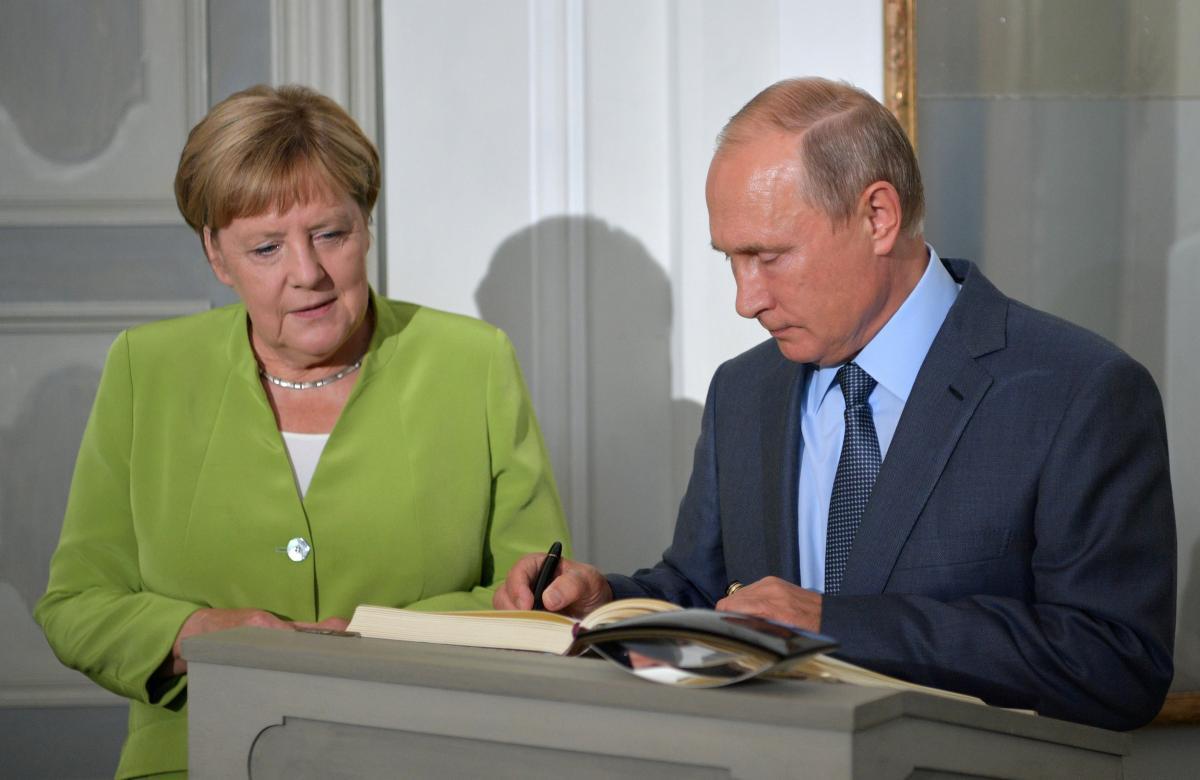 Владимир Путин и Ангела Меркель / REUTERS