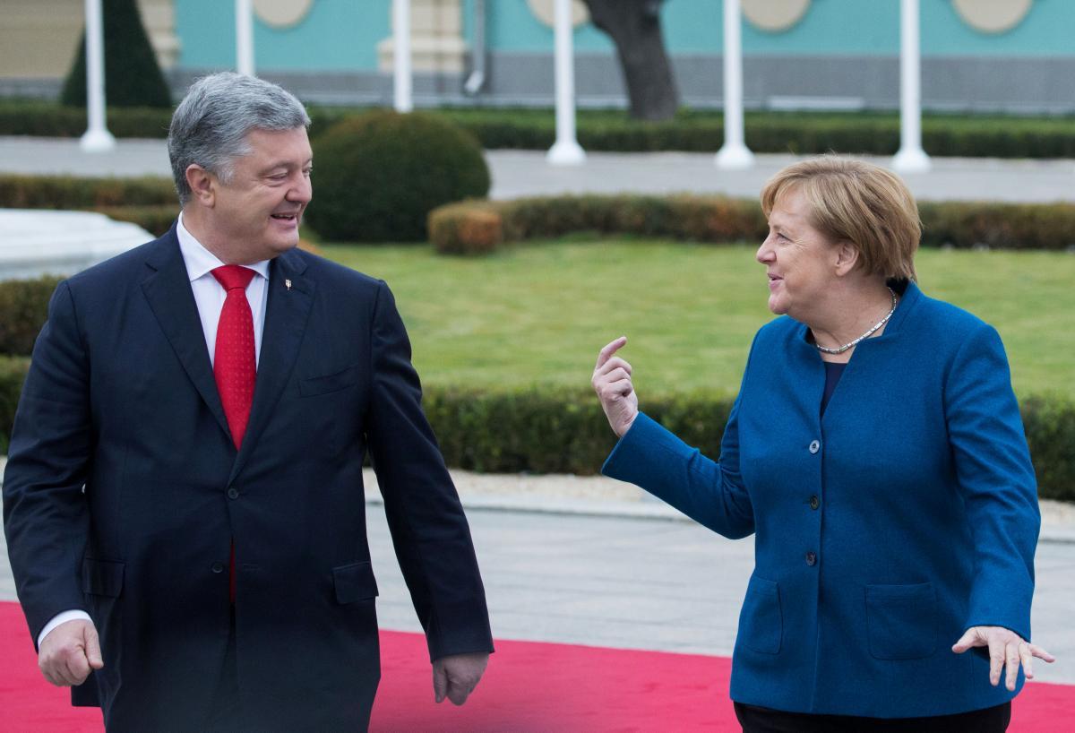 Петр Порошенко и Ангела Меркель /REUTERS
