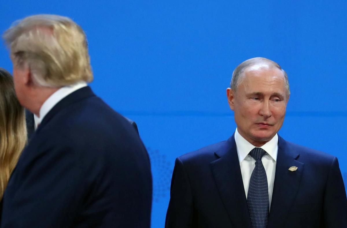 Дональд Трамп прошел мимо Владимира Путина на саммите G20 / REUTERS