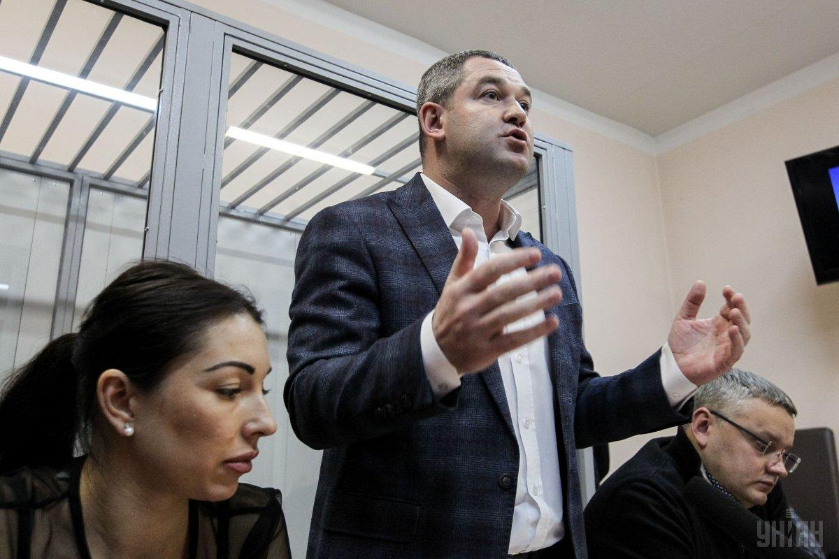 Myroslav Prodan (center) in court / Photo from UNIAN