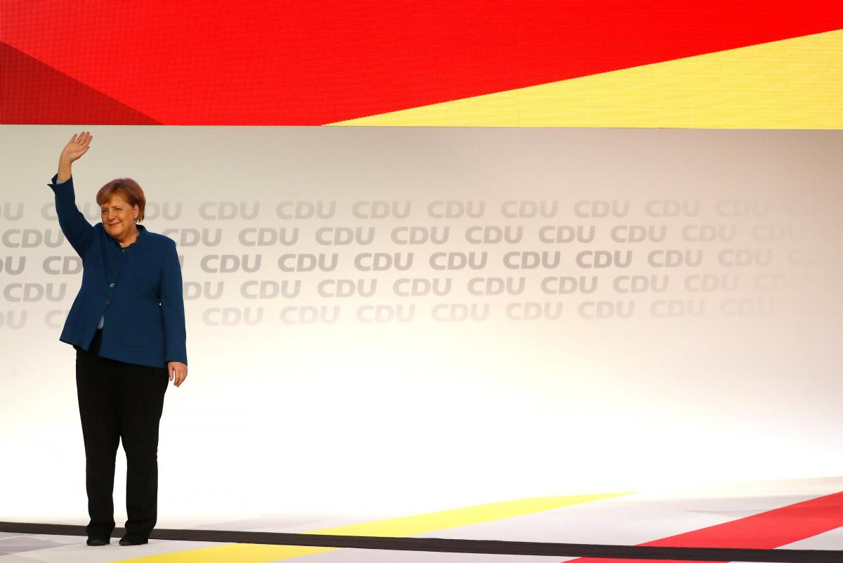 Merkel steps down as CDU leade...