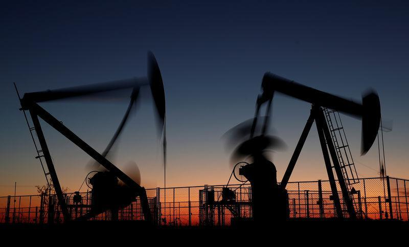 Oil prices retreat as concerns over supply glut, economic slowdown linger