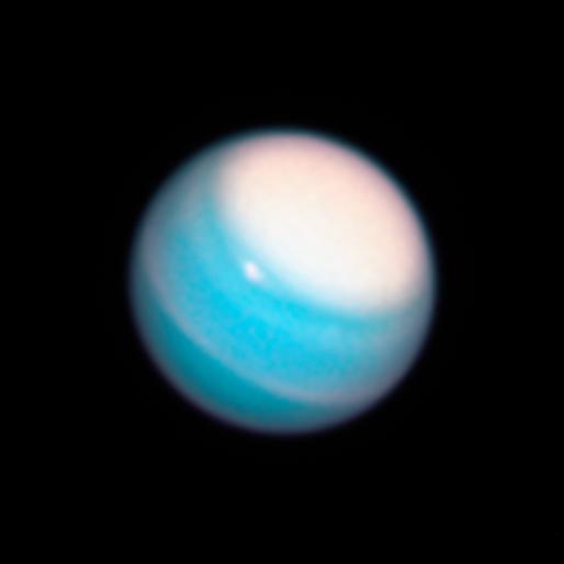 Насеверном полюсе Урана видна гигантская яркая область белого цвета / фото hubblesite.org