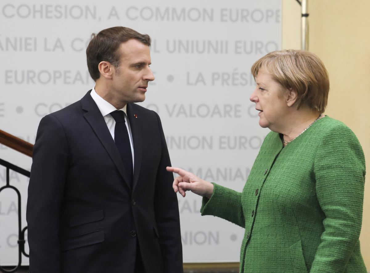 Ангела Меркель и Эммануэль Макрон / REUTERS