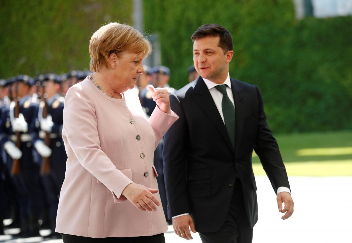Angela Merkel and Volodymyr Zelensky / REUTERS
