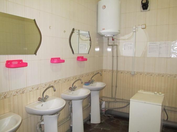 Минимальный комфорт точно есть: с горячей водой и стиральной машинкой / Фото центра предоставлено пресс-службой администрации ГУИС