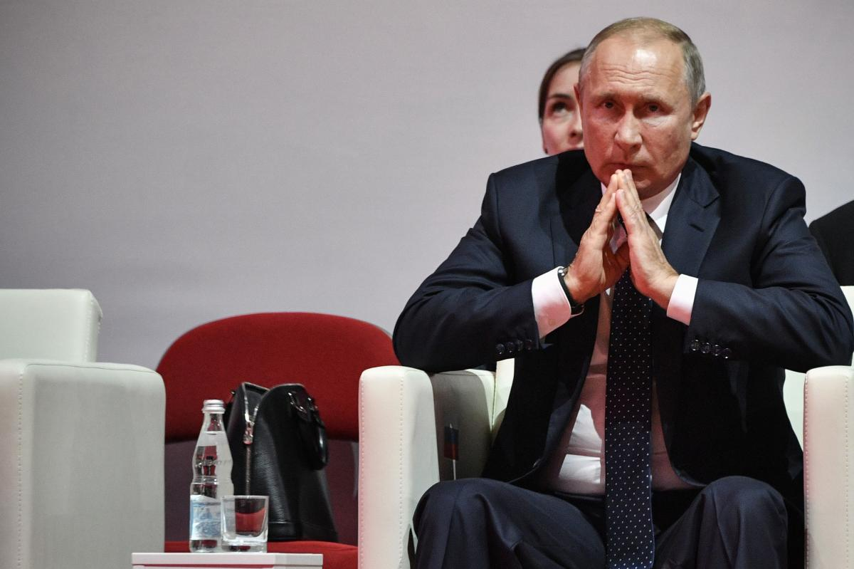 Vladimir Putin is one of the four Normandy leaders / REUTERS