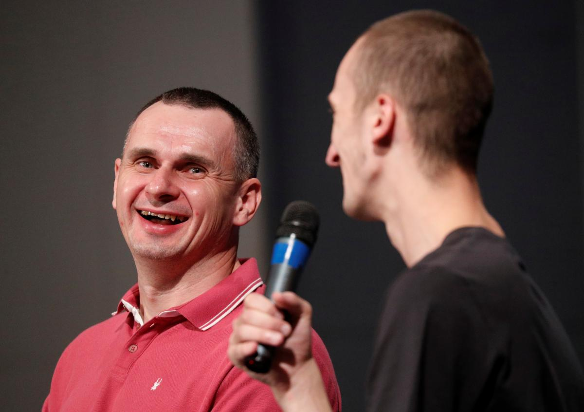 Sentsov (left) and Kolchenko (right) at their first press event after release / REUTERS