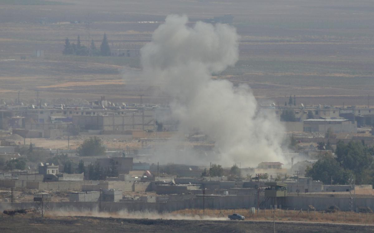 Дым над сирийским городом Рас-эль-Айн / REUTERS