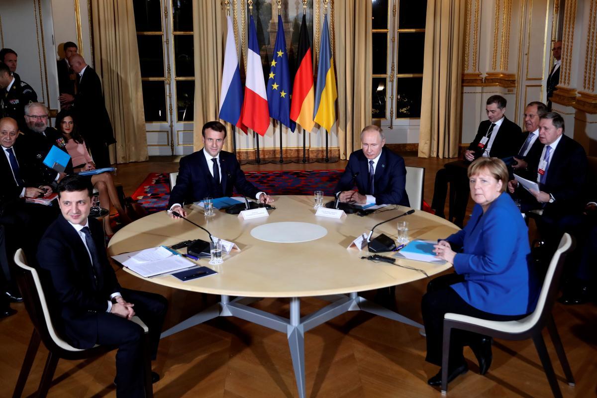 """Участники """"нормандской четверки"""" за столом переговоров / REUTERS"""