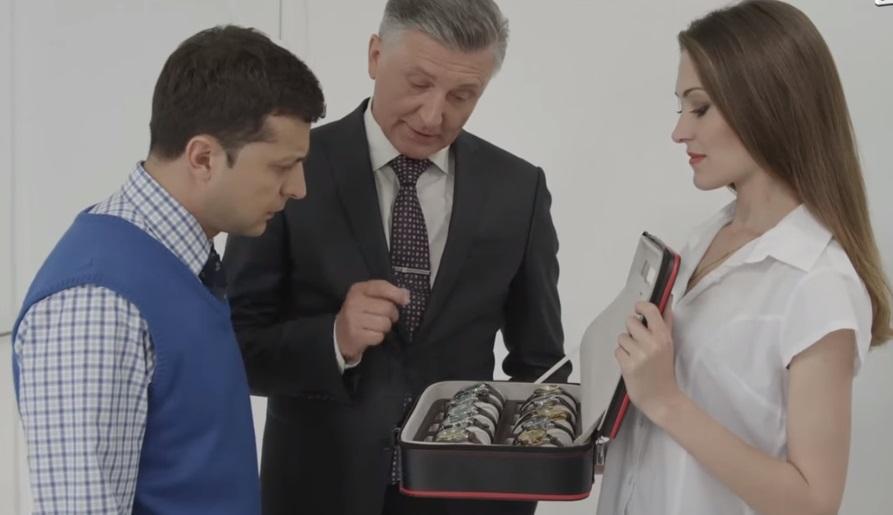 Screenshot from the sitcom: Holoborodko is looking atan expensive make of Swiss watch, Hublot