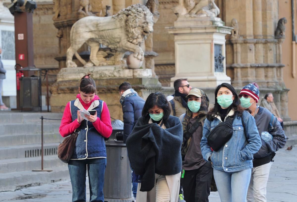 ВОЗ признала, что в мире бушует пандемия / Иллюстрация REUTERS
