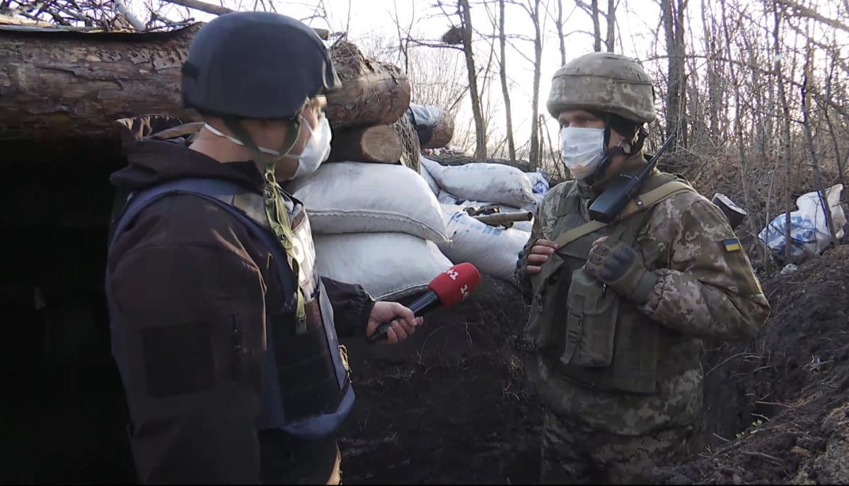 Військові на передовій у медичних масках / скріншот