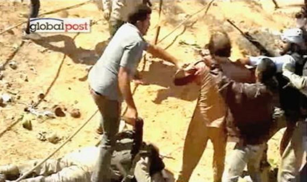 Каддафі позбувся влади, життя, а Лівія досі перебуває в стані громадянської війни / Муаммара Каддафі вбивають, Фото: REUTERS