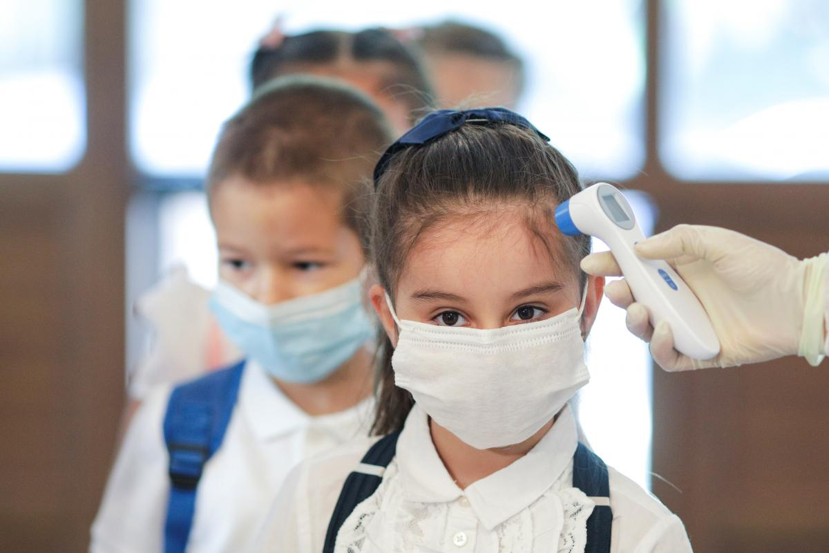 New coronavirus cases in the past day included 242 children / REUTERS