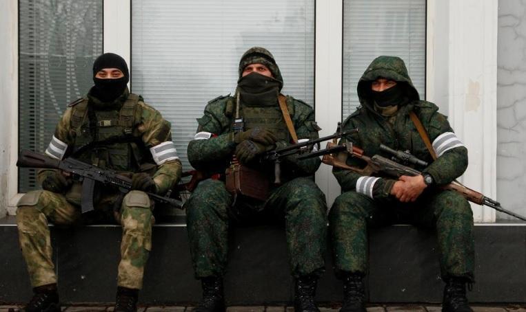 ООС новости - боевики трижды обстреляли позиции ВСУ / REUTERS