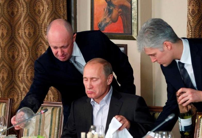 Санкции - ЕС ввел санкции против Пригожина / Евгений Пригожин слева, фото REUTERS
