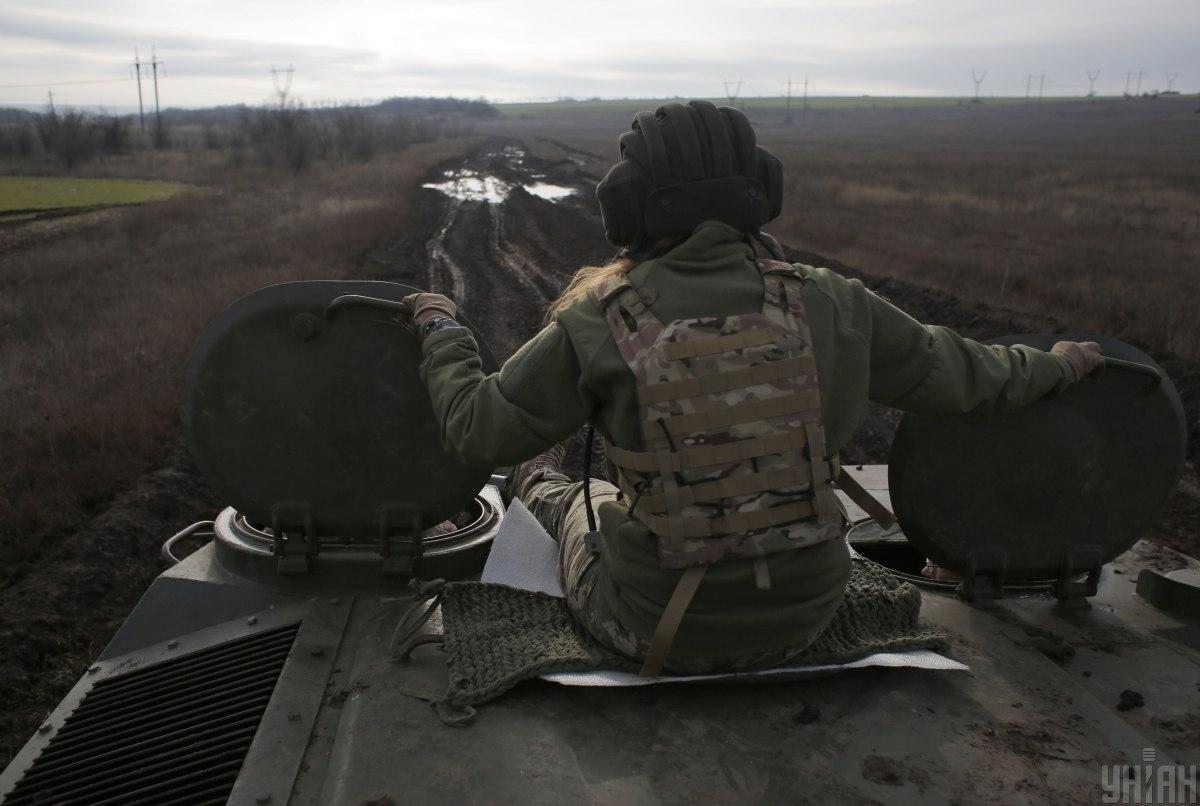 Ukrainian soldier killed by enemy sniper in Donbas warzone / Photo from UNIAN