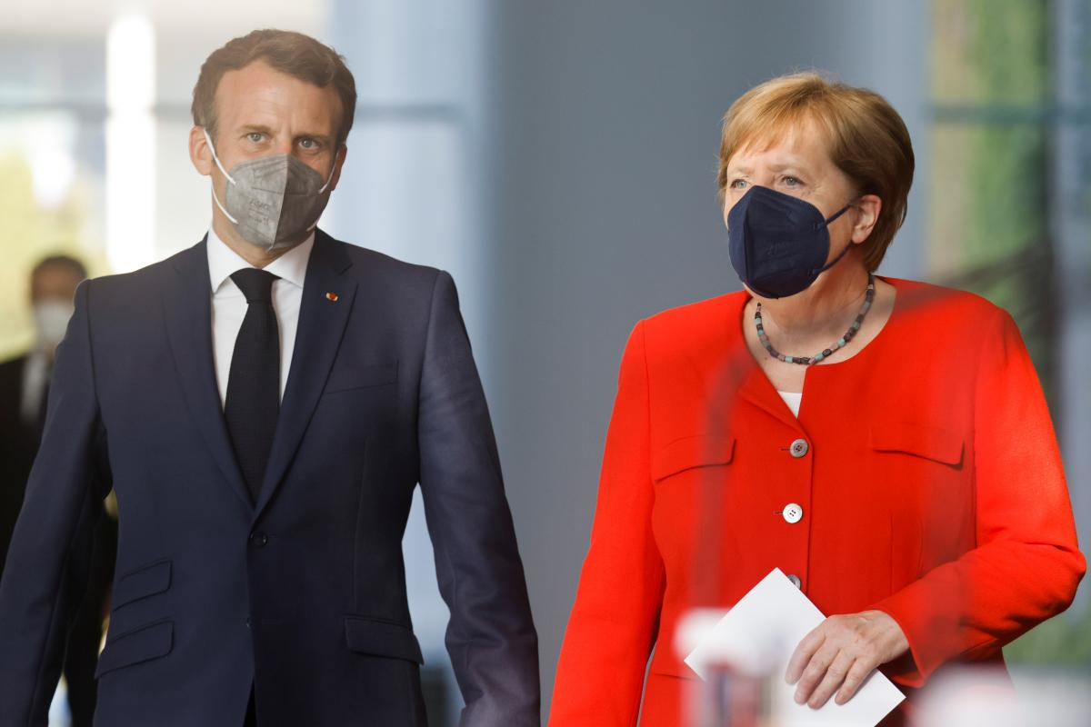Анґела Меркель і ЕммануельМакрон / фото REUTERS