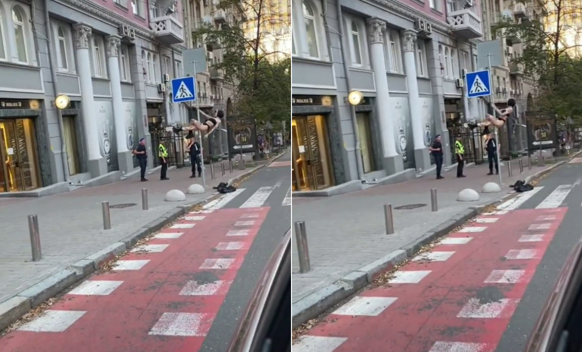 Неизвестная девушка оседлала знак пешеходного перехода / скриншот