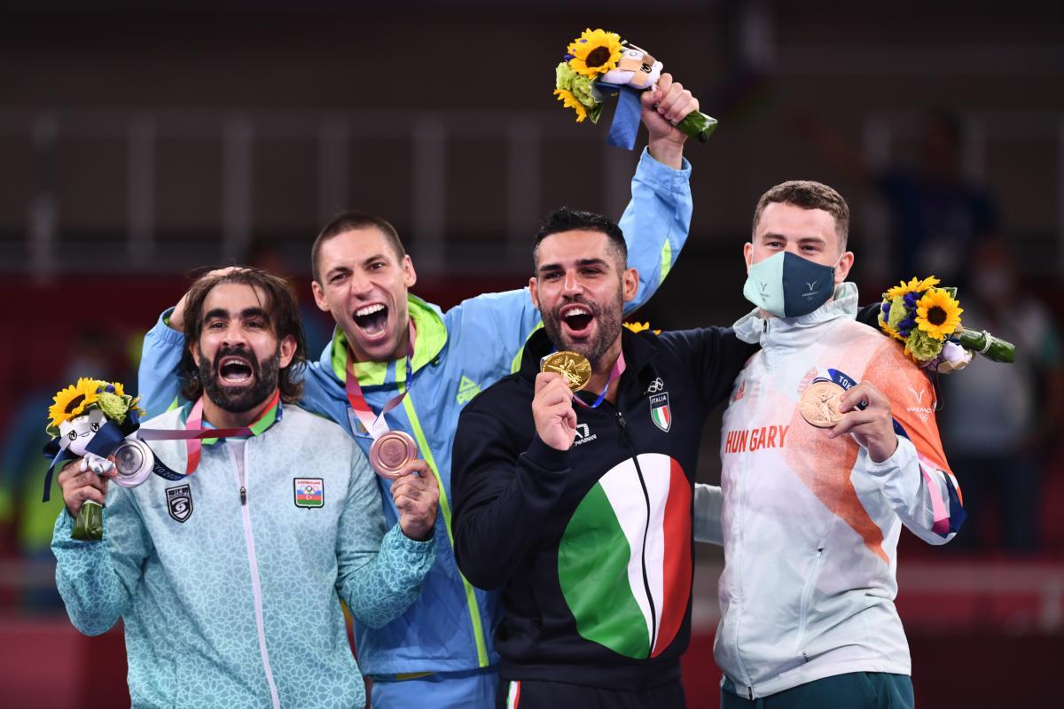 Победитель и призеры Олимпиады / фото REUTERS